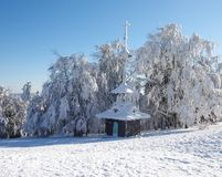 Wooden chapel in the winter mountains royalty free stock images