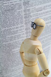 Wooden character and dictionary Stock Image