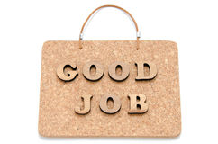 The wooden character of. GOOD JOB on a corkboard Royalty Free Stock Photos