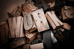 Wooden characters collection. Cardboard box with lots of wooden typescript letters Stock Photo