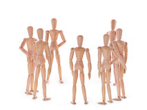 Wooden characters discussion. Wooden dummies characters group on white. Discussion, meeting and teamwork concept Royalty Free Stock Images