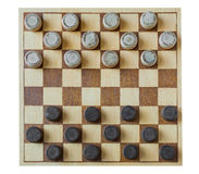 Wooden checkerboard with checkers spaced on table isolated Royalty Free Stock Photography