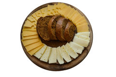 Wooden Cheese plate with bread isolated on white. Different Types of Cheese on the wooden plate with slices of bread, isolated on white Stock Photography