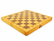 Wooden chess board. Isolated on a white background Stock Photo
