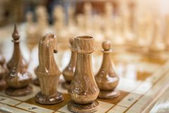 Wooden chess on the board royalty free stock photos