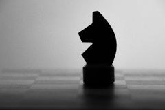 Wooden chess board and chess piece black silhouette Royalty Free Stock Photo