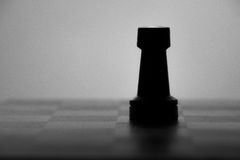 Wooden chess board and chess piece black silhouette Royalty Free Stock Photos