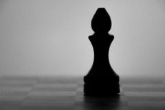 Wooden chess board and chess piece black silhouette Stock Photography