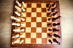 Wooden chess board with figures Royalty Free Stock Photo
