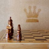 Wooden chess board with figures on table Royalty Free Stock Images