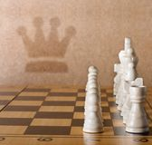 Wooden chess board with figures on table Stock Photo