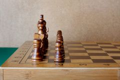 Wooden chess board with figures on table Royalty Free Stock Photography