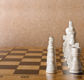 Wooden chess board with figures on table Royalty Free Stock Photo