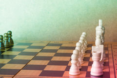 Wooden chess board with figures on table Stock Photos