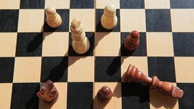 Wooden chess board male hand. Day light stock video footage
