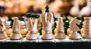 Wooden chess on board Royalty Free Stock Images