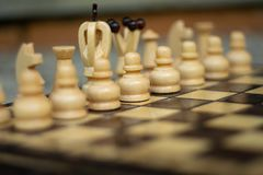 Wooden chess on chess board stock image