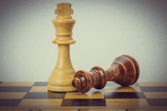Wooden chess on the chessboard Royalty Free Stock Image