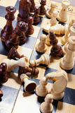 Wooden chess on the chessboard Stock Image