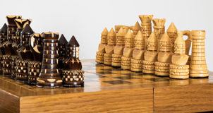 Wooden chess on the chessboard Royalty Free Stock Photo