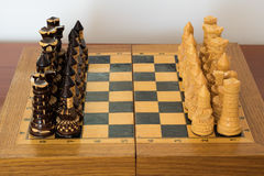 Wooden chess on the chessboard Royalty Free Stock Photography