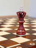 Wooden chess figures on game board Stock Photo
