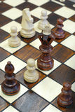 Wooden chess figures on game board Stock Photos