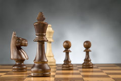 Wooden chess game pieces Stock Photos
