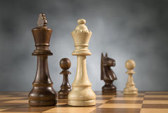 Wooden chess game pieces Royalty Free Stock Photo