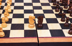 Wooden chess and horse Royalty Free Stock Image