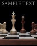 Wooden Chess kings on black. Blackboard High resolution. 3D image stock illustration