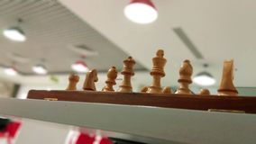 Wooden chess piece on chess board ready to play. stock photos