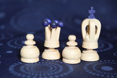 Carved wooden chess pieces. Closeup of white carved wooden chess pieces on decorative background Stock Photo