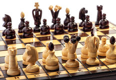 Wooden chess pieces on a board ready to play Royalty Free Stock Images