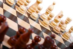 Wooden chess pieces on the board Royalty Free Stock Photography