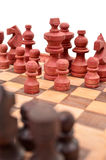 Wooden chess pieces on a chess board is unique Stock Photos