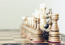 Wooden chess pieces on a chessboard, leadership concept on white background royalty free stock images