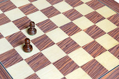 Wooden Chess pieces on Chessboard Stock Photos