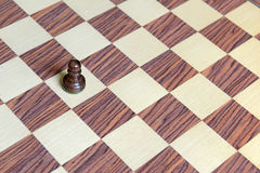 Wooden Chess pieces on Chessboard Stock Photo