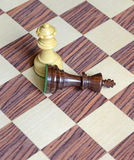 Wooden Chess pieces on Chessboard. Wooden Chess pieces on wooden rosewood Chessboard Stock Image