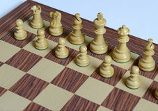 Wooden Chess pieces on Chessboard. Wooden Chess pieces on wooden rosewood Chessboard Stock Photography