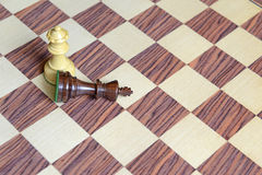 Wooden Chess pieces on Chessboard. Wooden Chess pieces on wooden rosewood Chessboard Royalty Free Stock Image