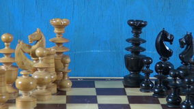Wooden chess pieces on chessboard and sandglass stock footage