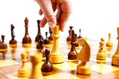 Wooden chess pieces on a chessboard Stock Photography