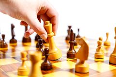 Wooden chess pieces on a chessboard Stock Images