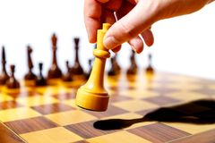Wooden chess pieces on a chessboard Stock Image