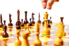 Wooden chess pieces on a chessboard Royalty Free Stock Photography
