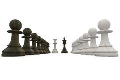 Wooden chess pieces facing off Stock Images