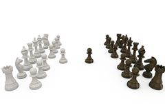 Wooden chess pieces facing off Royalty Free Stock Images
