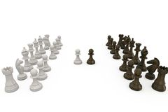 Wooden chess pieces facing off Stock Photo